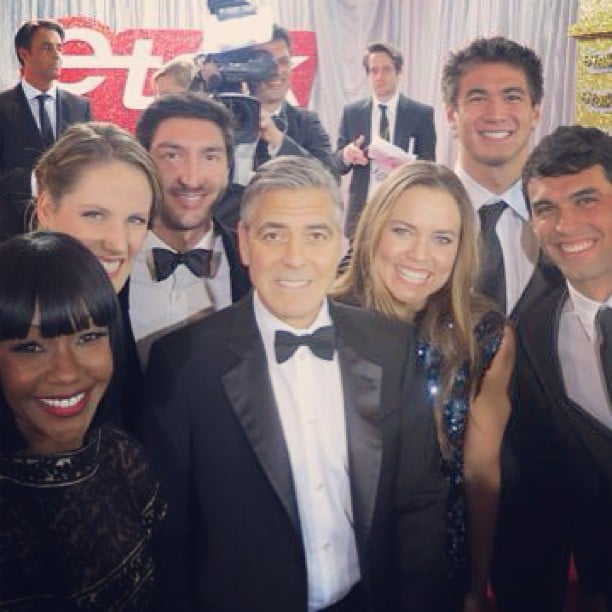 George Clooney posed with a group of Olympic athletes