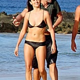 A bikini-clad Penélope and husband Javier Bardem took a walk on the beach while vacationing with friends in Brazil in July 2010.