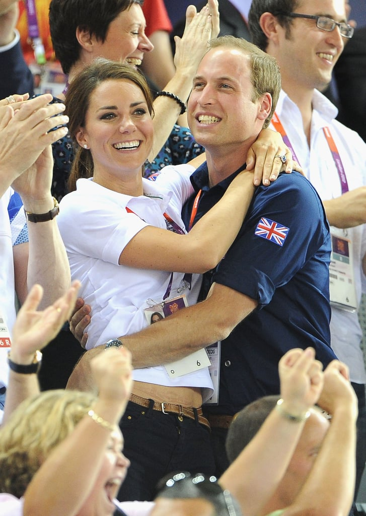 Kate Middleton and Prince William wrapped their arms around each other at London's Velodrome during the Olympics today. They were watching the track cycling finals with Prince Harry and celebrated the British team's gold medal victory over France with a sweet embrace and enthusiastic cheers. The cycling group not only grabbed the win but also set the world record for the fastest men's team sprint time. Kate and William have been showing affection during the Games and held hands while watching an equestrian event earlier this week. They have plenty more competitions to attend in the coming days, with William expected to be at swimming tomorrow and Kate to be in the stands during Great Britain's women's hockey game.