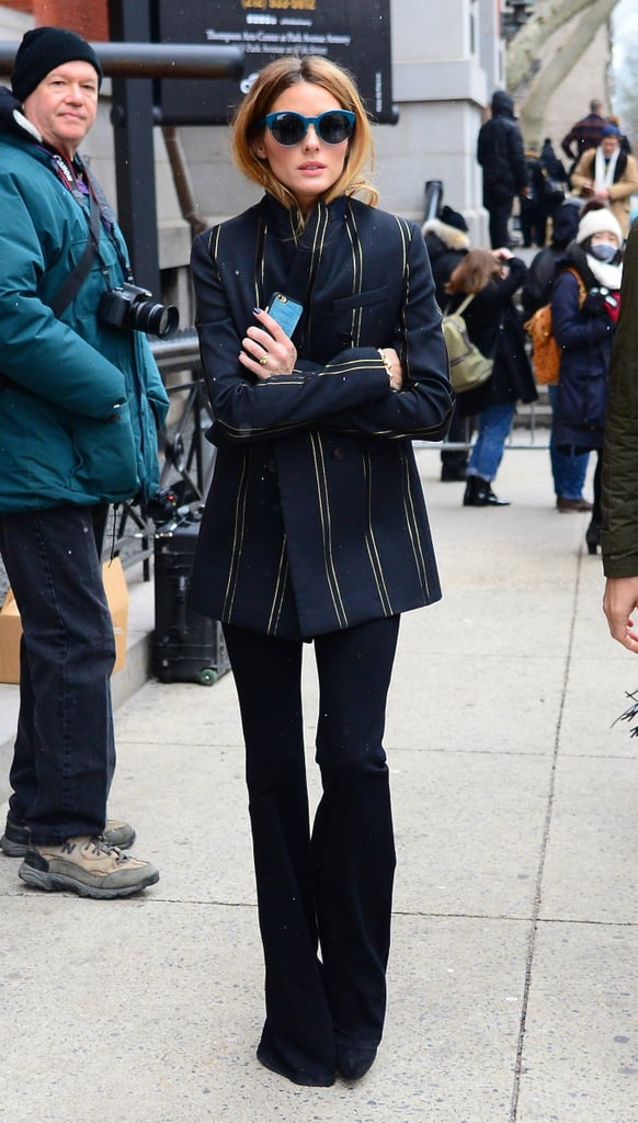 Olivia outfitted flares with a striped blazer for a '70s moment outside the Tommy Hilfiger show.