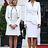When French President Emmanuel Macron and his wife Brigitte Macron visited the White House on April 24, Melania coordinated with Brigitte in white. She wore a Michael Kors Collection ensemble from the Spring '18 collection and Christian Louboutin pumps. It wasn't long before Melania's hat drew comparisons to Beyoncé's Formation look on Twitter.