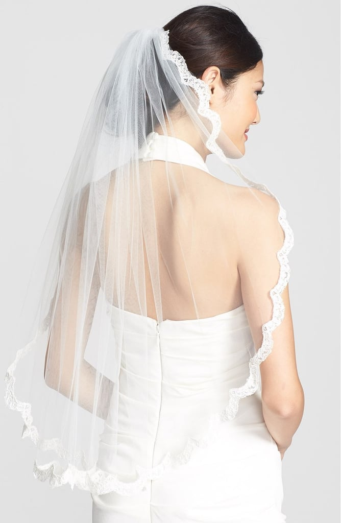For brides who love lace, this little detail on the veil's boarder ($528) is perfection.