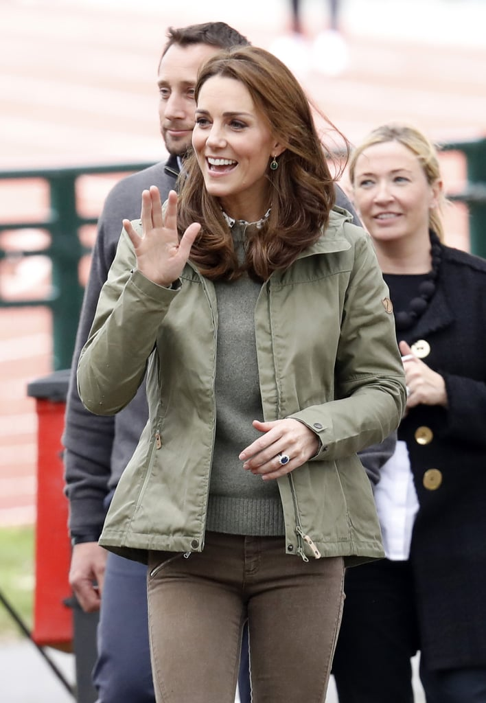 Kate Middleton is back from maternity leave! After giving birth to her third child, Prince Louis, in April, the duchess returned to her royal duties when she visited Sayers Croft Forest School and Wildlife Garden in London on Tuesday, Oct. 2. Casually dressed in brown skinny jeans, an olive green sweater, a matching jacket, and brown boots, Kate looked relaxed and carefree as she chatted with teachers at the school and adorably mingled with some of the school children.  Kate has generally stayed out of the spotlight during her maternity leave, but she has attended a few special events with the royal family, such as Prince Harry and Meghan Markle's wedding, Trooping the Colour, and Prince Louis's royal christening. Even though Kate is returning to her royal duties, she might not attend Princess Eugenie's upcoming nuptials. While her children Princess Charlotte and Prince George are expected to play a special role in the bridal party, her sister, Pippa Middleton, is due to give birth to her first child around the same time. See more pictures from Kate's most recent appearance ahead!