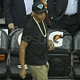 Jay-Z wearing a black hat and shirt.
