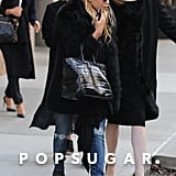 Mary-Kate Olsen and Ashley Olsen walked to their car in NYC.