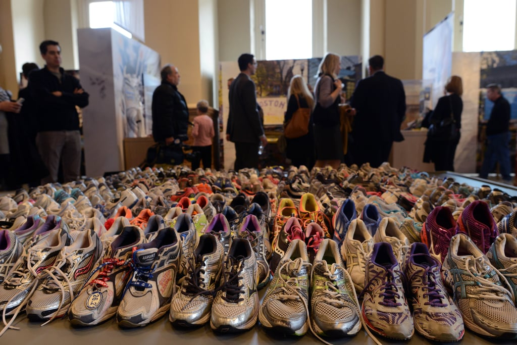 A giant display of running shoes is part of the library's Boston Marathon bombing memorial exhibition.