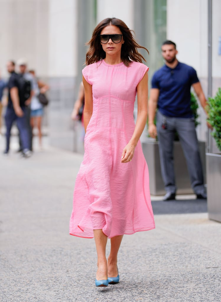 A pink dress and blue heels are all one needs.