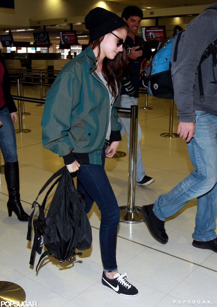 Kristen Stewart wore a black cap and a green jacket while traveling from Sydney's airport.
