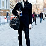 20. Even if you're wearing all black, edgy extras, like an oversize beanie, will keep your outfit on-trend.