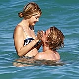 Former couple Gigi Hadid and Cody Simpson engaged in playful PDA while splashing around in Miami in March 2015.