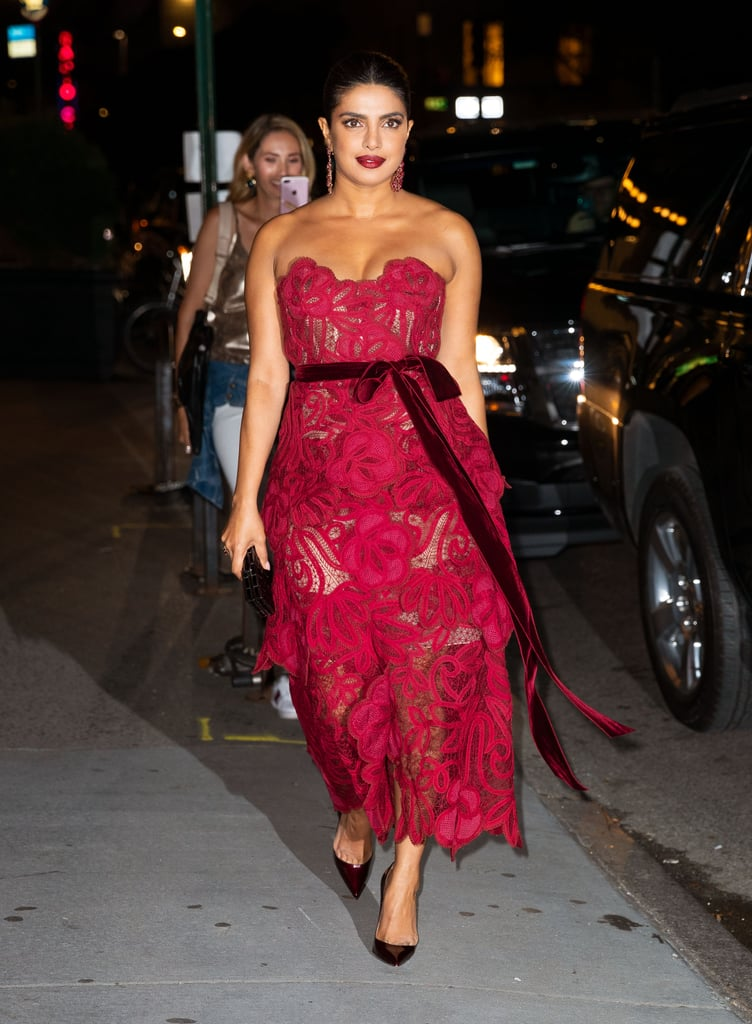 Priyanka Chopra channeled her inner princess on Thursday night when she attended the Vanity Fair Best Dressed List event during New York Fashion Week. The Quantico actress took the theme of the party to heart, choosing to wear a romantic strapless lace gown by Oscar de la Renta that definitely fit the brief. The striking ruby red dress, from the Fall 2019 collection, featured a double-layered ballet-length skirt with three dimensional flowers, and a sweetheart neckline that made the most of the lace pattern. It was finished at the waist with a velvet tie belt. Priyanka accessorized her pretty look with towering Christian Louboutin heels and a box clutch, and swept her hair back to show off a pair of red chandelier earrings.  The finished look was the perfect mix of romantic and sexy — we're sure husband Nick Jonas would agree. Keep reading to take a closer look at this showstopper of a dress.      Related:                                                                                                           Priyanka Chopra Turned the Street Into a Runway in This Sexy Fringed Number