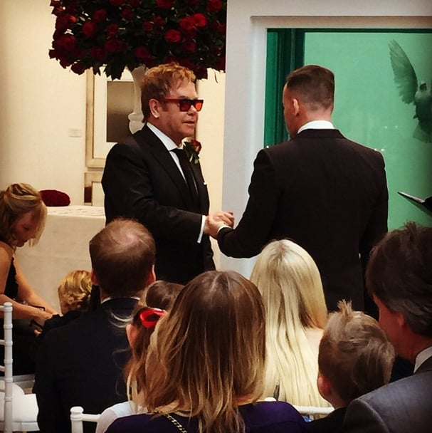 "Elton John married longtime partner David Furnish in an intimate ceremony on Sunday. Elton shared behind-the-scenes snaps from his nuptials on Instagram, which he joined on Saturday. The pair had been in a civil partnership for nine years and have two children together — Zachary and Elijah — who both served as ring bearers during the ceremony. Elton shared a particularly adorable moment with Elijah, who clung to his fathers' legs during the vows while holding onto a stuffed animal. Celebrity guests included Ed Sheeran, David and Victoria Beckham and their children, and model Lara Stone. While Elton and David have been dating since 1993, the two announced their plans to officially tie the knot after same-sex marriages in England became legal in March 2014. At the time, David explained his and Elton's decision to get fully married: ""We don't feel the need to take an extra step legally. But since we're committed for life, we feel it's really important to take that step and take advantage of that amazing change in legislation. We all live by example."""