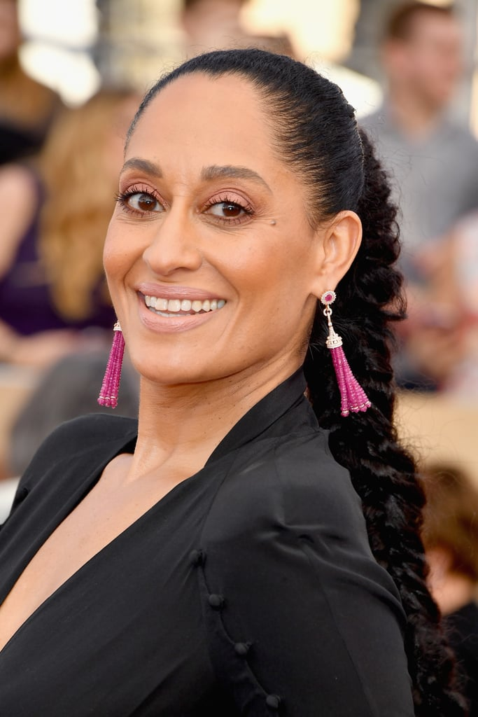 Tracee Ellis Ross appeared at the 2017 Screen Actors Guild Awards in a flattering black gown featuring arm cutouts and delicate button closures — but it's her jewelry we couldn't stop looking at. The Black-ish star emphasized her Ulyana Sergeenko dress with tassel earrings from Narcisa Pheres and colossal rings from Lydia Courteille, L'Dezen, and Yvel Jewelry. Her extravagant accessories actually brought us back to her stunning appearance at this year's Golden Globes, where she rocked a whopping 12 rings! See her commitment to the stacked ring trend ahead.