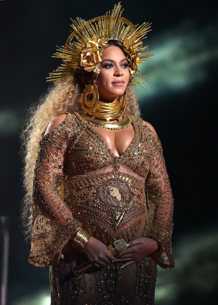 "Making her first public appearance since announcing her pregnancy this month, Beyoncé had our jaws dropping when we got a glimpse of her on stage at the 2017 Grammy Awards. Aside from the fact that she was covered from head to toe in gold, Queen Bey had us bowing down to her shimmering look. Adorned with gold roses, the crown just reaffirmed her royal status. Beyoncé's matching gold collar and sheer metallic dress made for the perfect maternity look.   Beyoncé wasn't the only Carter dressed royally. Blue Ivy rocked a Prince-inspired pink suit that had us immediately saying ""awww."" Keep reading to see the stunning photos of Beyoncé, and then check out her insane performance here."