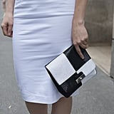 Black and white and bold all over for this handheld clutch.