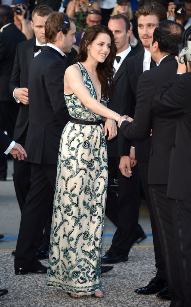 Kristen Stewart chatted with her cast mates at the On the Road premiere in Cannes.