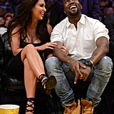 Kim Kardashian and Kanye West looked stylish while sitting courtside at the May 2012 playoff game between the LA Lakers and the Denver Nuggets.