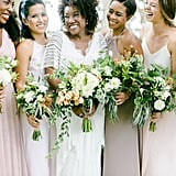This bride had her squad dress in pale pinks, off-white, and beige.