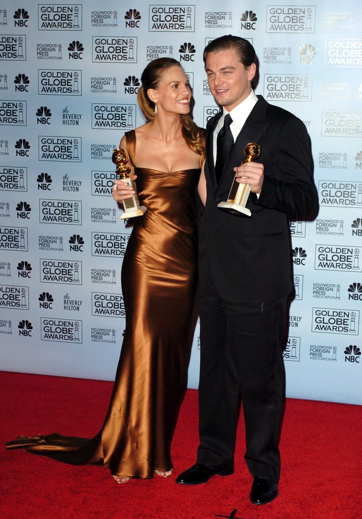 He won the best actor Golden Globe award in 2005 for his role in The Aviator and smiled for photos backstage with best actress winner Hilary Swank.