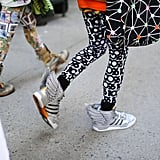 Spotted on the streets at Jeremy Scott's show: bold high-tops and bold legwear.