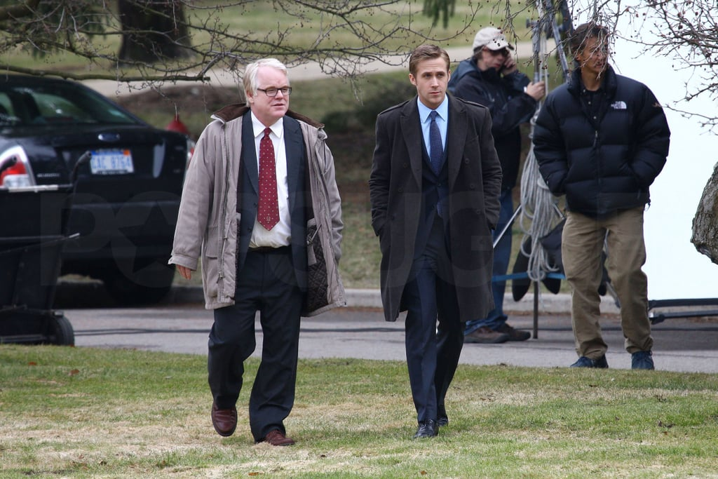 Ryan Gosling was back on the Bloomfield Hills, MI, set of The Ides of March yesterday afternoon with his costar Philip Seymour Hoffman. The duo walked around the lawn of the Christ Church Cranbrook while their director, George Clooney, amused himself with a glow-in-the-dark ball. The cast has been working on the film for nearly a month, and last Friday were spotted shooting in Ann Arbor with Evan Rachel Wood. She missed out on the most recent fun as she had to go to NYC for last night's premiere of HBO's Mildred Pierce —and Evan revealed on the red carpet that George has blessed her with the nickname of Schnoz!