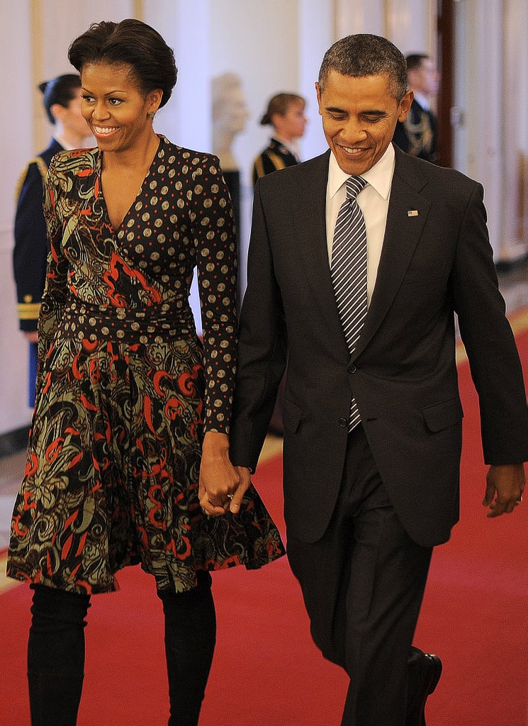 For a White House event, Michelle stepped it up in a mixed-print wrap dress and black boots.
