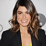 Nikki Reed went for an understated, pretty look, allowing her bold eyebrows to stand out against neutral pinks and browns.