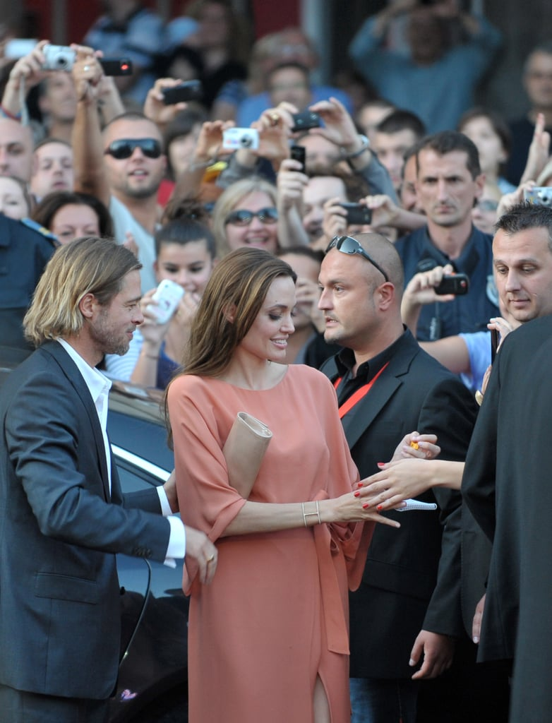 "Angelina Jolie and Brad Pitt were together in Bosnia yesterday to attend the Sarajevo Film Festival. It was there that Angelina, in Elie Saab, was awarded with the Honorary Heart of Sarajevo distinction during the closing ceremonies. The country is close to her heart, as it was the setting for her upcoming directorial debut The Land of Blood and Honey. While accepting the honor before a clapping crowd, Angelina said, ""I will start crying if you don't stop — I told Brad in the car I was afraid I was going to cry. . . I am so honoured to be here at this festival. There is no greater example of the strengths of the artists and the festival that began during the war and grew stronger every year."" She also spoke about more personal matters in a recent interview with the Financial Times. Angelina said of her and Brad's six kids, ""They are all learning about each other's cultures as well as being proud of their own. So it's not like just the boys get to do the Asian thing. They all have their flags over their beds and their individual pride. . . We owe Vietnam a visit, because Pax is due. Z wants to get back to Africa, and Shiloh too. So everyone takes their turns in their country."""