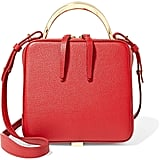 In fire-engine red, this The Volon Cube Mini Textured-Leather Shoulder Bag ($765) was meant to make a statement everywhere.