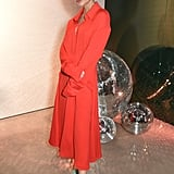 She proved that red can go with a lot of different hues by wearing a shirt dress with a pair of sparkly green heels.