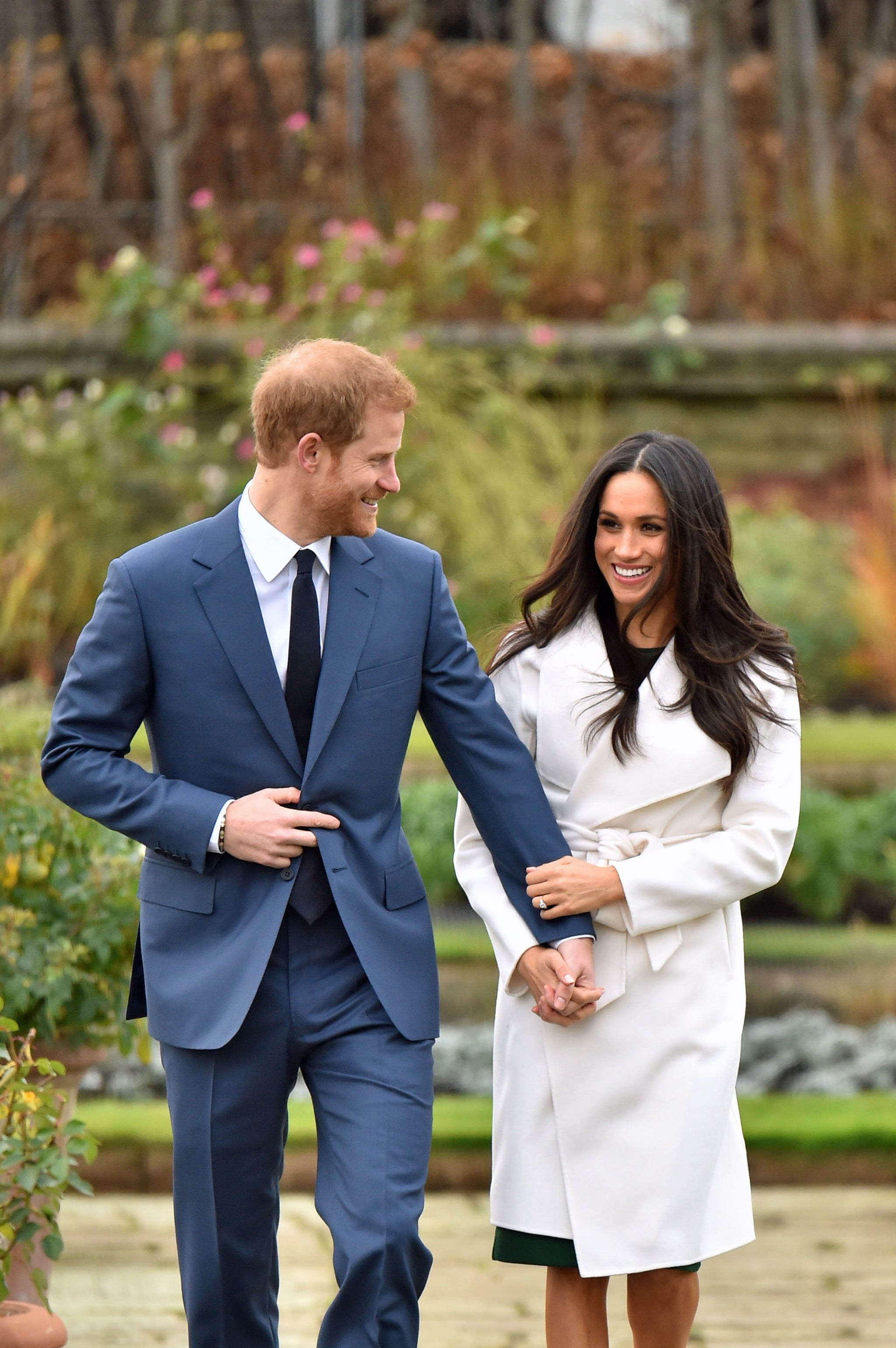Prince Harry and Meghan Markle in the Sunken Garden at Kensington Palace, London, after the announcement of their engagement. (Photo by Dominic Lipinski/PA Images via Getty Images)