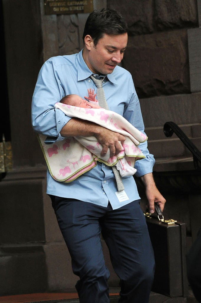 Jimmy Fallon looked happy — and maybe a little nervous — while holding his newborn daughter Winnie Rose in New York on August 8.