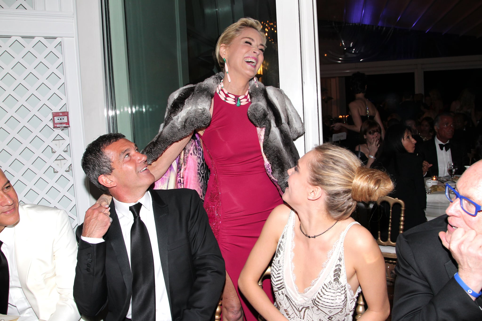 Sharon Stone laughed with Antonio Banderas and Cara.