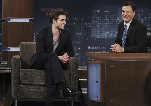 """Robert Pattinson swung by Jimmy Kimmel Live last night to chat all about his new movie Water For Elephants. The film, which is out tomorrow, features Reese Witherspoon and a full cast of supporting animal actors, and Rob spoke to Jimmy a bit about how he interacted with the four-legged creatures. Rob also revealed a childhood love of MC Hammer's '90s cartoon Hammerman —Jimmy even gave Rob a special Hammer gift Robert called """"the best thing I've ever gotten""""! Their conversation was the latest press effort in a long week for Robert. He kicked things off Monday on The Today Show with Matt Lauer before moving on to Live With Regis and Kelly and The Ellen DeGeneres Show."""