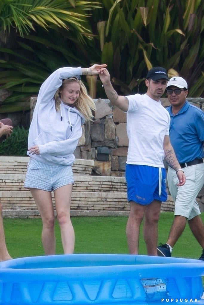 "After a busy few months, Joe Jonas and Sophie Turner are enjoying as much quality time together as they can. The couple, who is reportedly expecting their first child together, recently jetted off to Cabo San Lucas for a mini holiday. On March 7, the two were spotted playing Jenga and volleyball before hanging out poolside with friends. While Joe wore blue shorts and a white tee, Sophie covered up in a grey hoodie and shorts before wrapping up in a towel. Joe and Sophie even indulged in some adorable PDA as they pulled each other in for a kiss. At one point, Joe playfully twirled Sophie around as they danced barefoot on the grass. We wonder if Ed Sheeran's ""Perfect"" was playing the background? See more pictures from their romantic holiday ahead.       Related:                                                                                                           Sophie Turner and Joe Jonas Have the Sweetest Quotes About Their Relationship, Y'all"