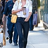 Candice Swanepoel's white button-down with crochet detail and white sneakers lent a crisp air to her skinny denim in NYC.