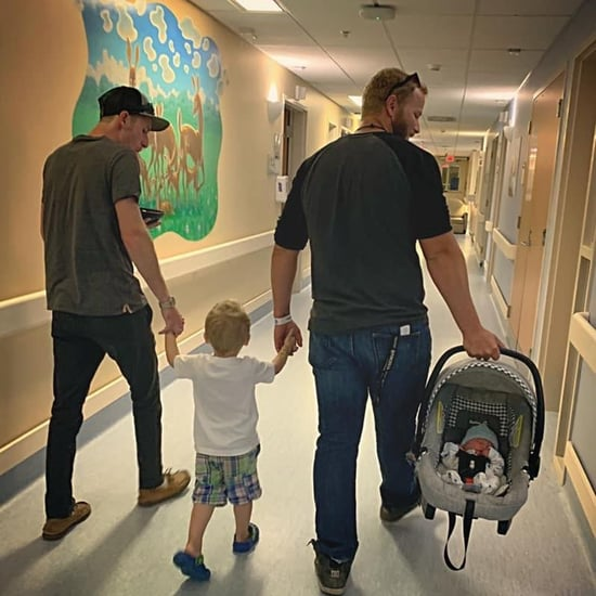 Photo of Dad and Stepdad Holding Boy's Hands at Hospital