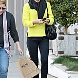 The bright hue of her knit made the stark black of everything else really stand out. It looks chic but is amazingly easy to re-create. All you need are favorite pairs of jeans and boots, and you're done.