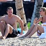 Chris and Gwyneth warmed up on the beach.