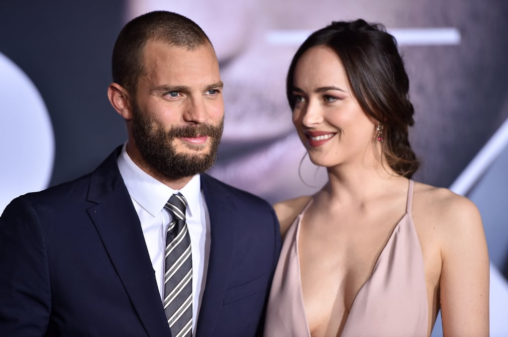 Jamie Dornan and Dakota Johnson were all smiles when they attended the LA premiere of Fifty Shades Darker on Thursday night. The onscreen love interests showed off their sweet chemistry as they shared a few laughs on the red carpet. Perfectly channeling their characters Christian and Ana, Jamie showed off his new buzzed haircut in a dark blue suit, while his costar kept things light in a plunging gown and simple braid. Needless to say, their picture-perfect appearance has us even more excited about the upcoming film.