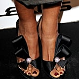 Naomie Harris wore black bow sandals.