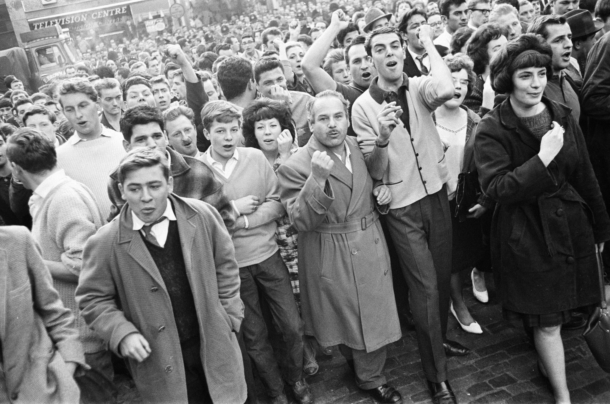 Ridley Road, London, Tuesday 31st July 1962: A large crowd gathers in the East End to disrupt a rally by former fascist leader Sir Oswald Mosley and members of his anti-Semitic Blackshirt group who had planned a rally in London's East End. Mosley and his group were assaulted and punched to the ground as soon as his meeting opened at Ridley Road, Dalston. Police closed the meeting within the first three minutes and made 54 arrests, one of which was Sir Oswald's son Max. (Photo by Bob Powell/Don Smith/Mirrorpix/Getty Images)