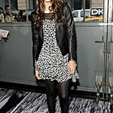 Nina Dobrev topped a dress with a leather jacket at DKNY.