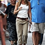 Jennifer wearing army green pants and a white tank in July 2009.