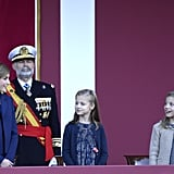 Queen Letizia shared a moment with her daughters during the National Day Military Parade in October.