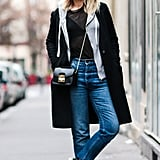 With Layered Outerwear and Jeans With Fishnets Underneath