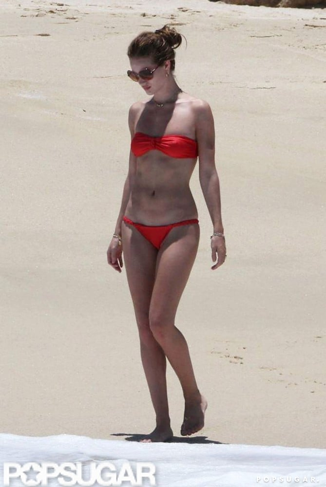 Model Rosie Huntington-Whiteley showed off her fit frame in a red bikini during a May 2011 beach trip.
