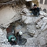 Syrian civil defense volunteers, the White Helmets, search for victims in Aleppo after an airstrike.