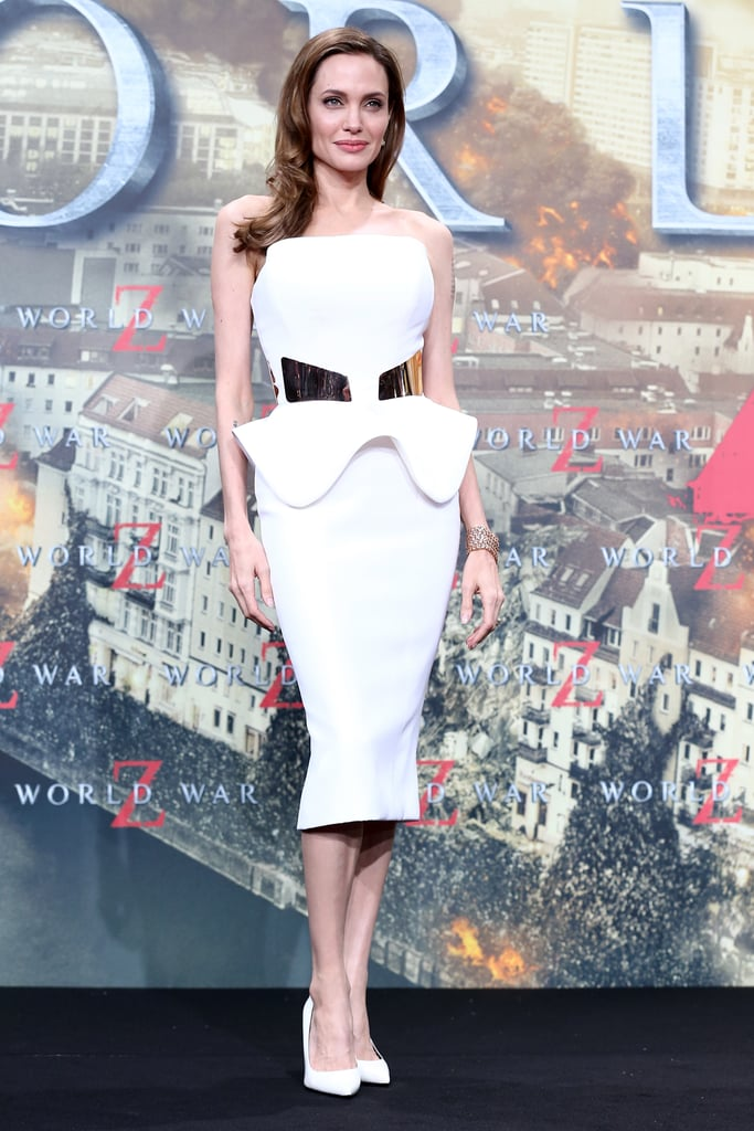 Angelina Jolie went for all-out white at the World War Z premiere in Berlin. She matched white pumps with a white strapless peplum ensemble, complete with futuristic gold plates at her waist.