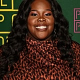 Amber Riley as the Emcee